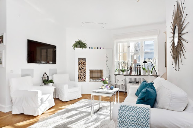All White Cozy Living Room With Turquoise Accents