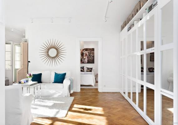 Mirror Wardrobe In White And Turquoise Living Room