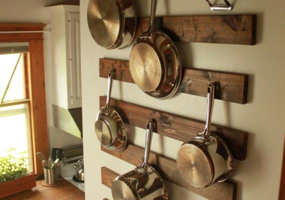 Hanging Pots And Wans On Wooden Rack Wall Mounted