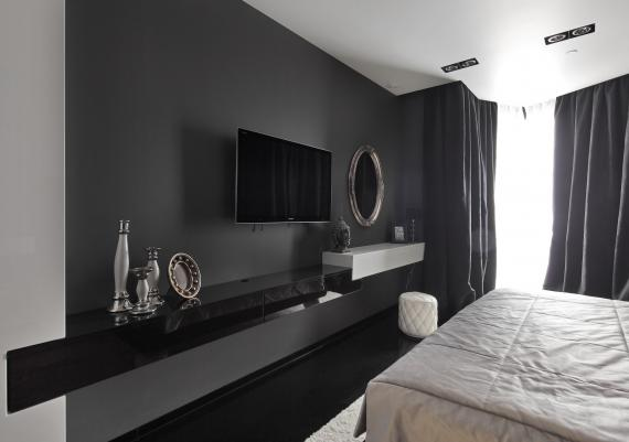 Led TV Panel Attached On Black Painted Wall In Bedroom