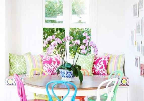 Mix-matched Brightly Colored Chairs In The Dining Room
